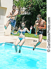 People jumping to swimming pool