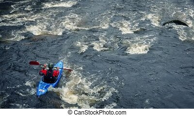 People Kayaking On Large Mountain River - High angle shot of...