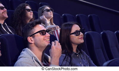 People laugh at the movie theater - Young people in 3D...