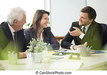 People laughing during business appointment