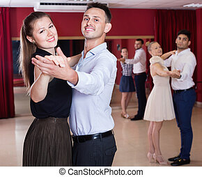 People learning to dance waltz in dancing class - Happy ...