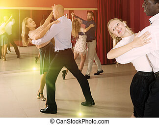 People learning to dance waltz - Young smiling people ...