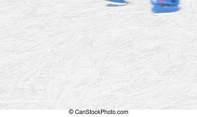 Closeup portrait of people legs in ice skates