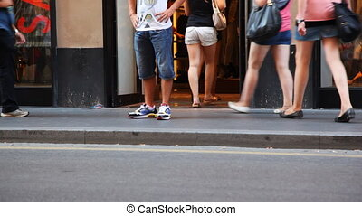 people legs in summer shoes go on street and come into shop...