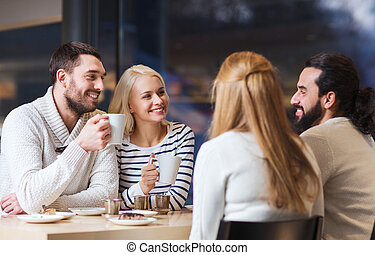 happy friends meeting and drinking tea or coffee