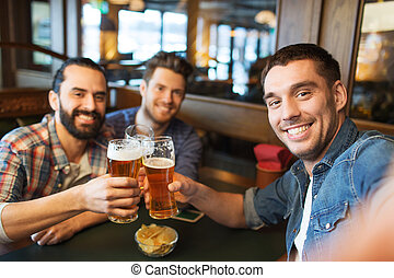 friends taking selfie and drinking beer at bar - people,...