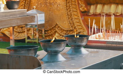 People Light Incense Sticks with Smoke in Buddhist Temple. Thailand. Pattaya