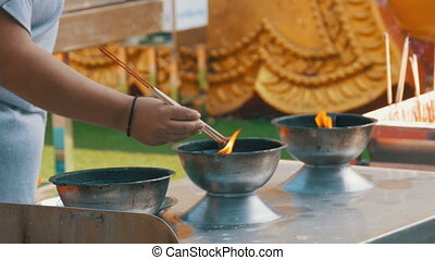 People Light Incense Sticks with Smoke in Buddhist Temple....