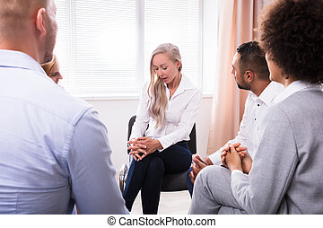 People Listening To Woman Talking About Her Problems