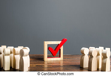 People look at the vot checkmark. Voting in the elections. Democratic institutions process, poll and referendum. . Lawmaking and the legitimacy of power. Politic system. Make a right choice