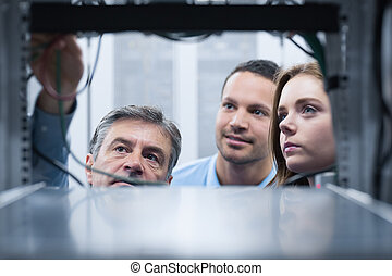 People looking into a server