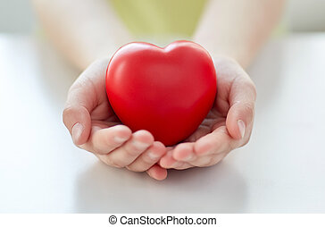 close up of child hands holding red heart - people, love,...