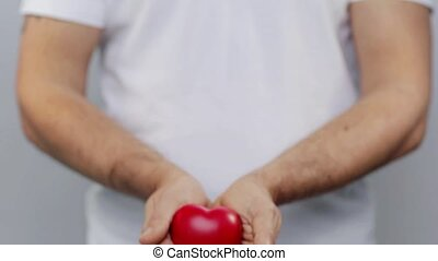 man holding red heart - people, love, charity, valentines...