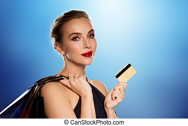 woman with credit card and shopping bags