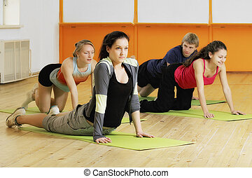 People make exercises on floor