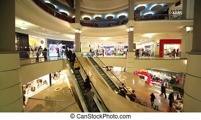 People moves on escalators in multiple floors trade center