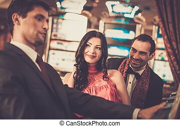 People near slot machine in a casino