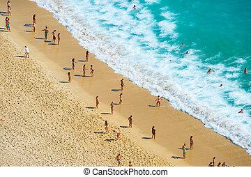 People ocean beach aerial view