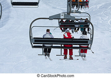 People on a chairlift, ski resort