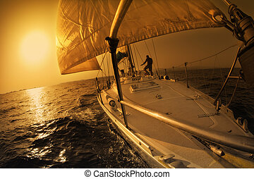 sail boat - people on a sail boat at the sunset