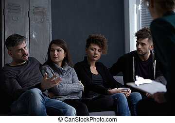 People on aa meeting - Young people with addictions on group...