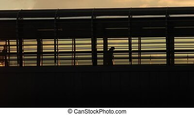 People on an overpass - People rushing at a station