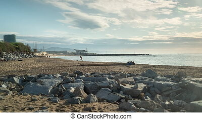 People on beach in morning, Barcelona, Spain - After 7 weeks...