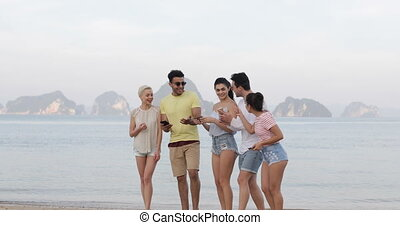 People On Beach Using Cell Smart Phones, Young Smiling Tourists Group Networking Online