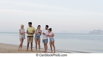 People On Beach Using Cell Smart Phones, Young Tourists Group Networking Online
