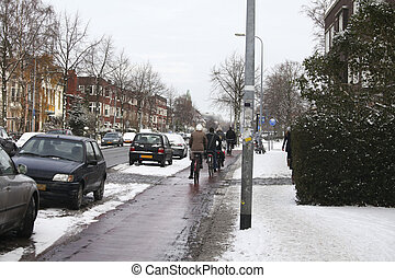 People on bicycles in winter