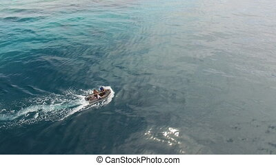 People on boat in the middle of the ocean