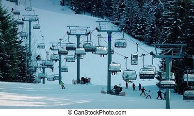 People On Busy Ski Slope - People practice and ski past on...