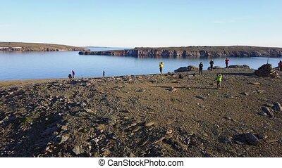 People on desolate Vaygach Island in desert of Arctic Ocean....