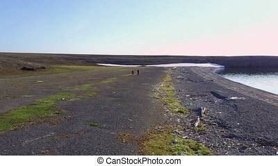 People on desolate Vaygach Island in desert of Arctic Ocean...