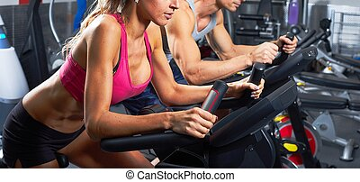 people on elliptical trainer - Group of people running on...