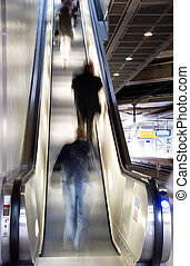 people on escalator - blurred people on an escalator in a...