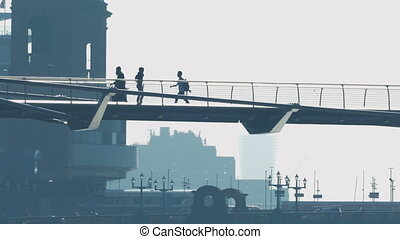 People On Footbridge With Train And Cars In The Background -...
