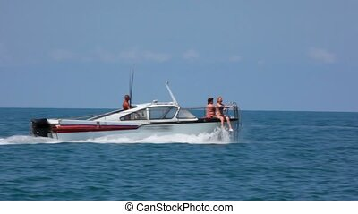 people on going pleasure boat in sea, tourism entertainment
