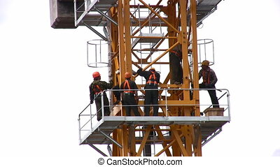 People on high building crane