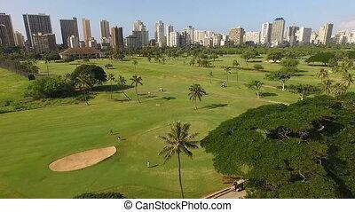 People on Honolulu Golf Course Waikiki Hawaii - Waikiki Golf...