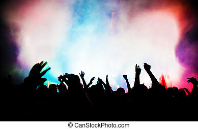 People with hands up having fun on a music concert / disco party.