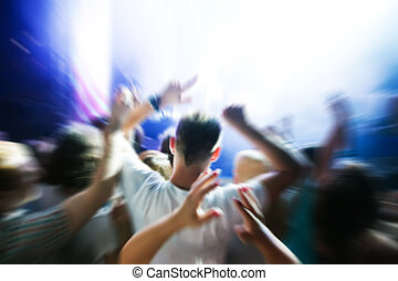 People on music concert, disco party. - People with hands up...