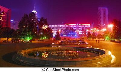 people on night festive square