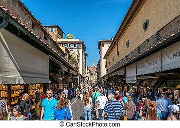People on Ponte Vecchio Bridge in Florence, Italy.