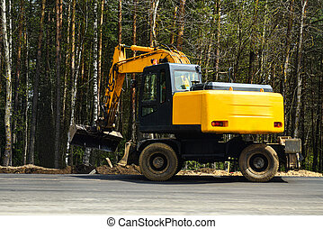 People on road equipment build asphalt pavement