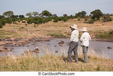 People on safari in Tanzania, Mara River