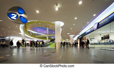 People on second floor new shopping and entertainment center TROYKA