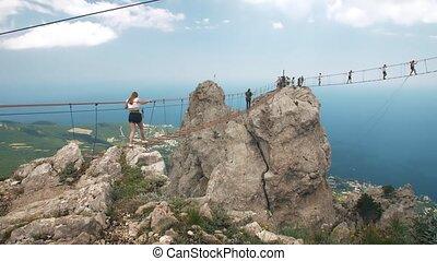 People on suspension bridge