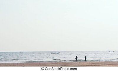 people on the background of the sea with boats