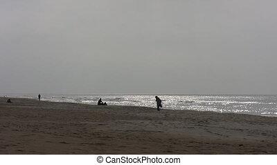 People on the beach in autumn